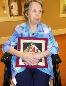 Mary Land Holding A Picture Quilt June 2014